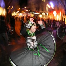Child spinning in costume
