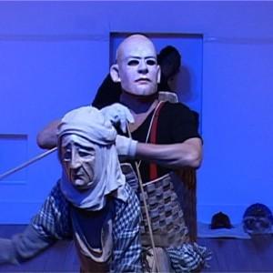 Artists Stephen Jon operates a puppet