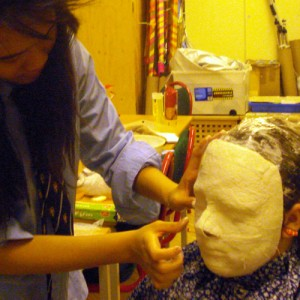 Girl moulds mask to a face