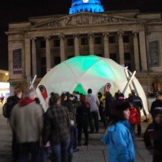 People queue to enter the illuminated Dome