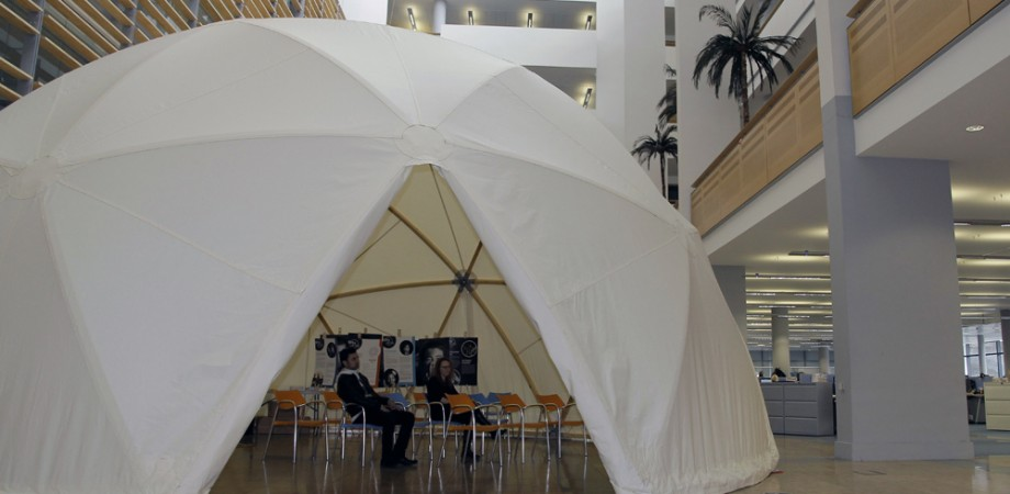People sat inside a covered Dome structure