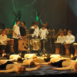 Dancers and musicians perform on stage