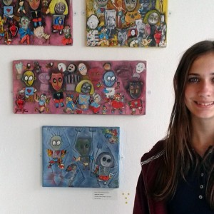 Teenger standing with artwork