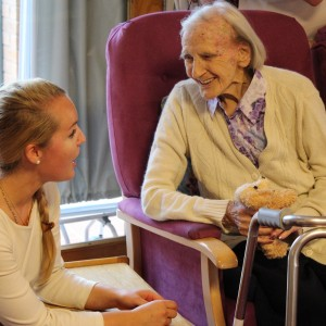 Care home resident enjoys a musical performance