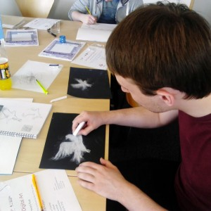 Young person drawing with chalk