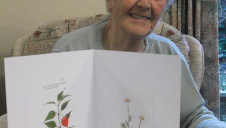 Older woman with booklet