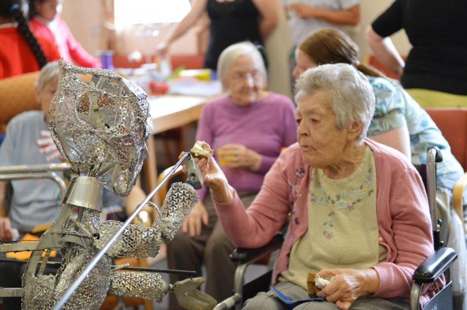 Older people meet puppet
