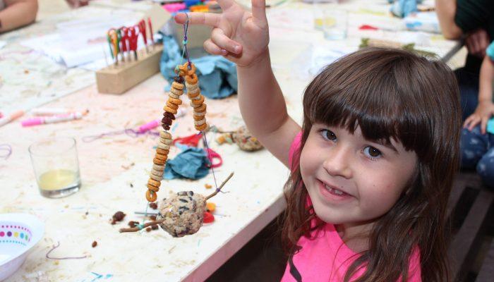 Happy child holding artwork