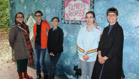 Express Yourself participants with their mural