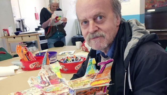 Get Creative workshop member with their artwork