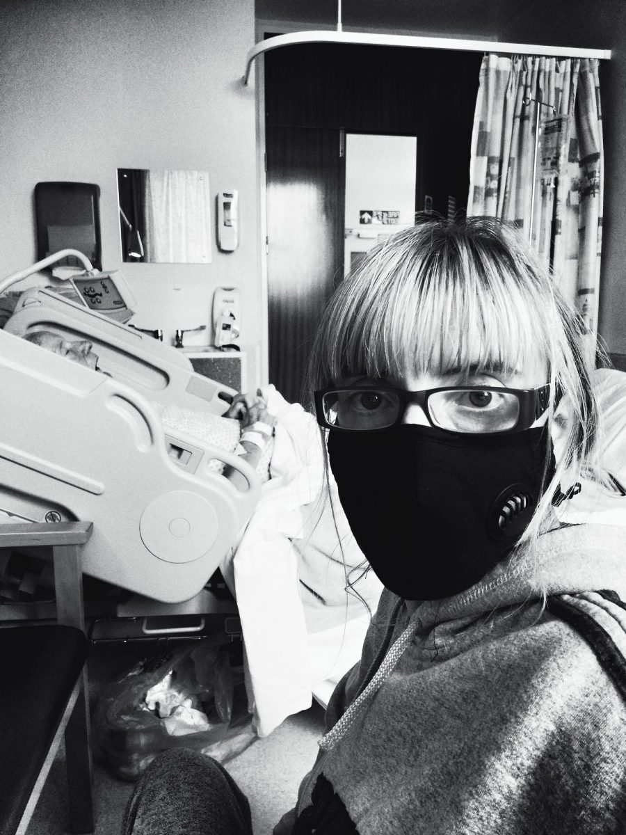 Grace Eden in hospital with a face mask