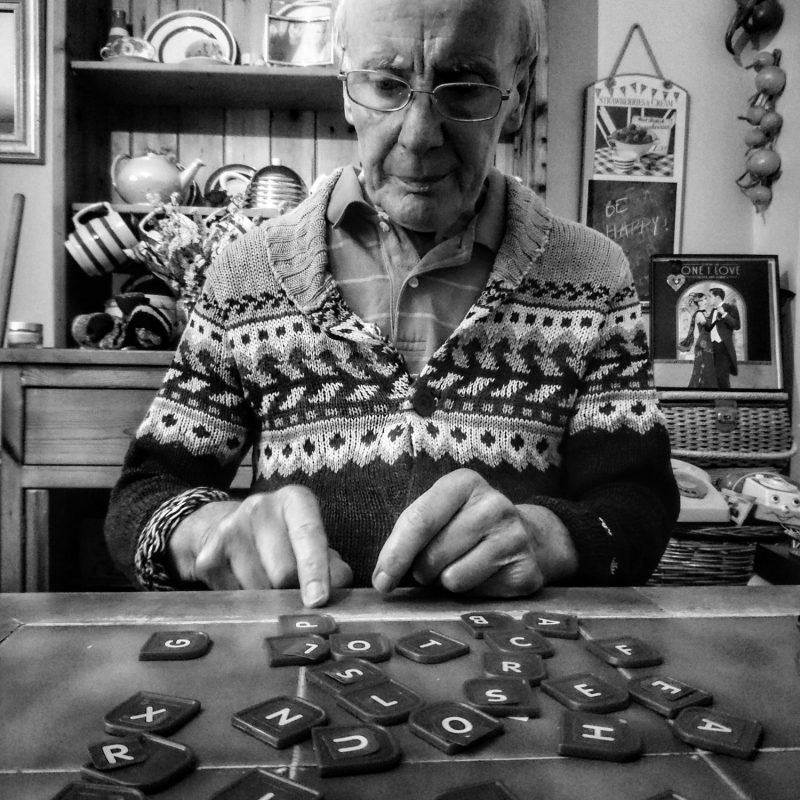 Grace Eden's father playing with Scrabble tiles