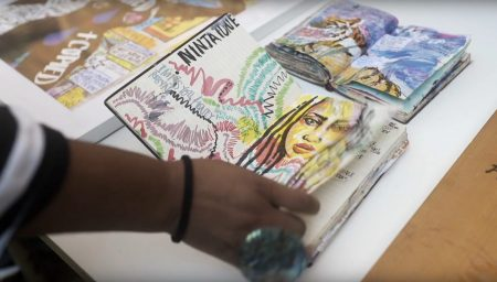 Artist Honey Williams leafing through sketchbook