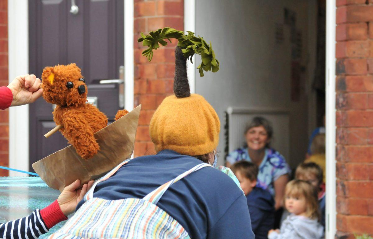 Teddy bear puppet on a doorstep