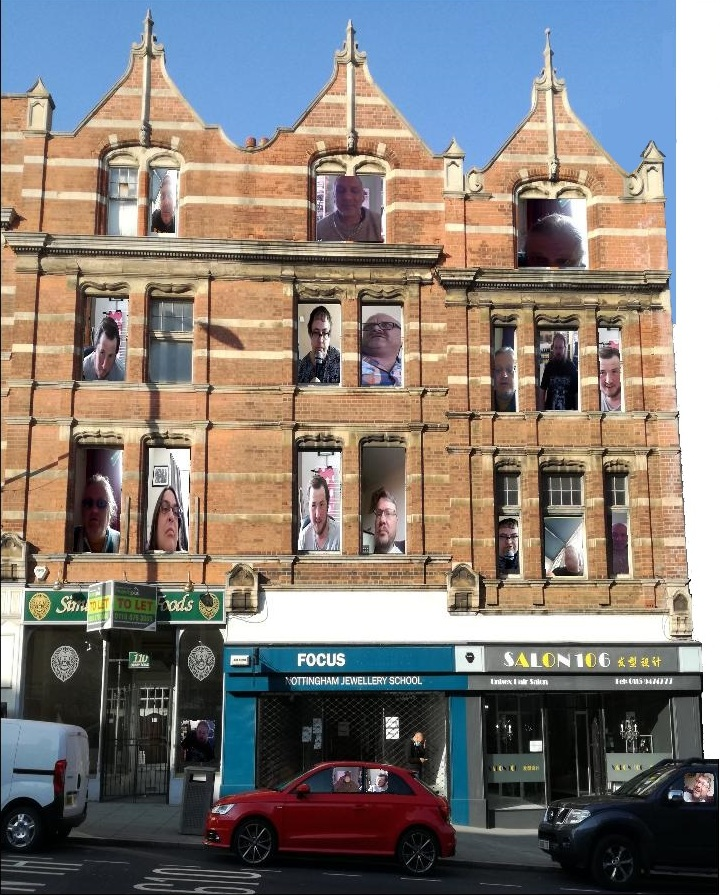 Portraits edited on to Nottingham building front