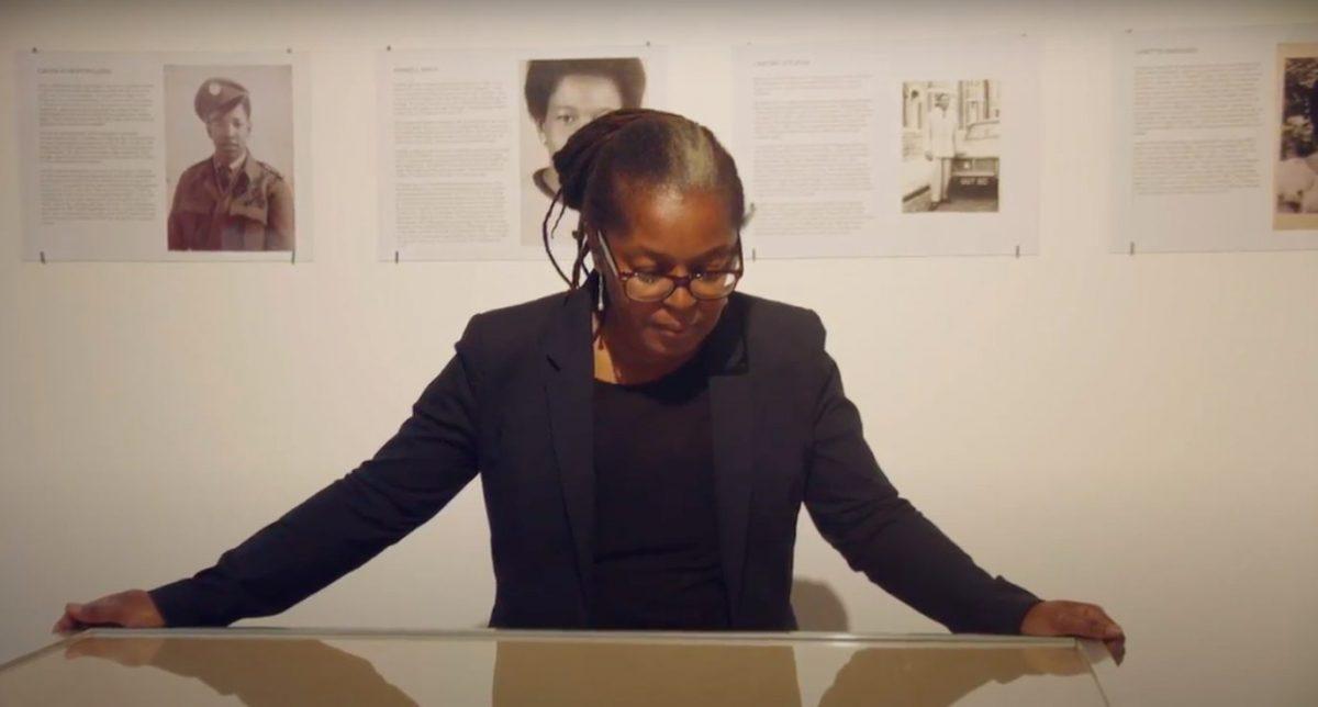 Poet Panya Banjoko looking at a display case