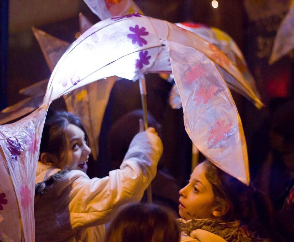 Child holding bird lantern