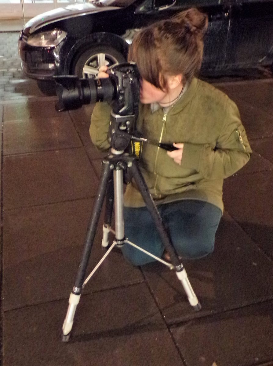 Young person taking a photograph