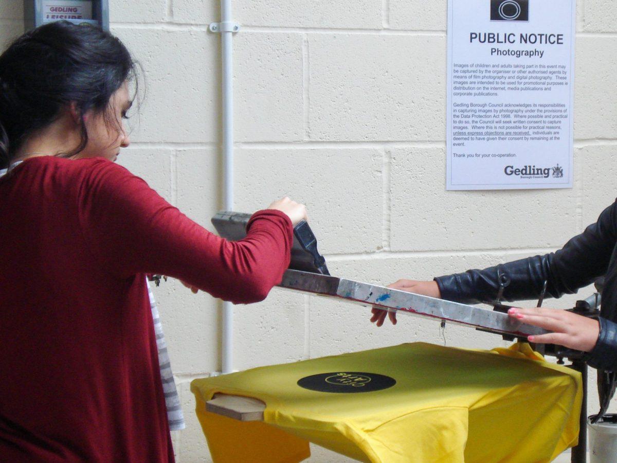 Participants making screen prints