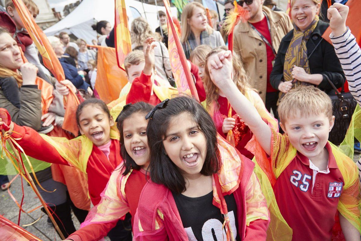 School children in costume at a public event