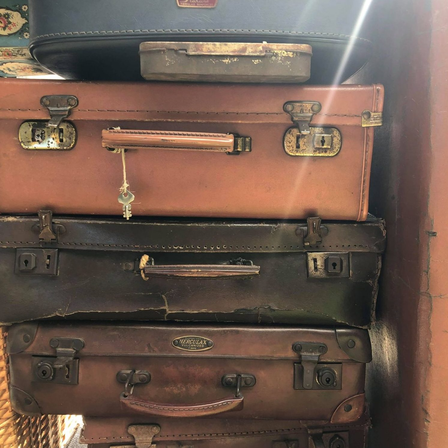 A pile of leather suitcases