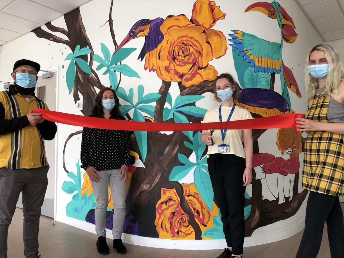 Alastair Flindall, Megan Russell, Kate Duncan & Megan Dawes cut a ribbion to launch a mural
