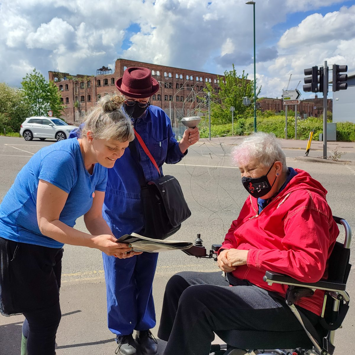 Artist shows map older woman using a wheelchair